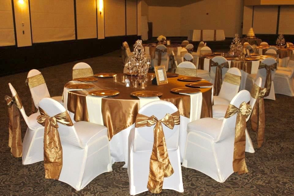 Party Gear banquet hall decoration with lovely chair cover and golden sashes