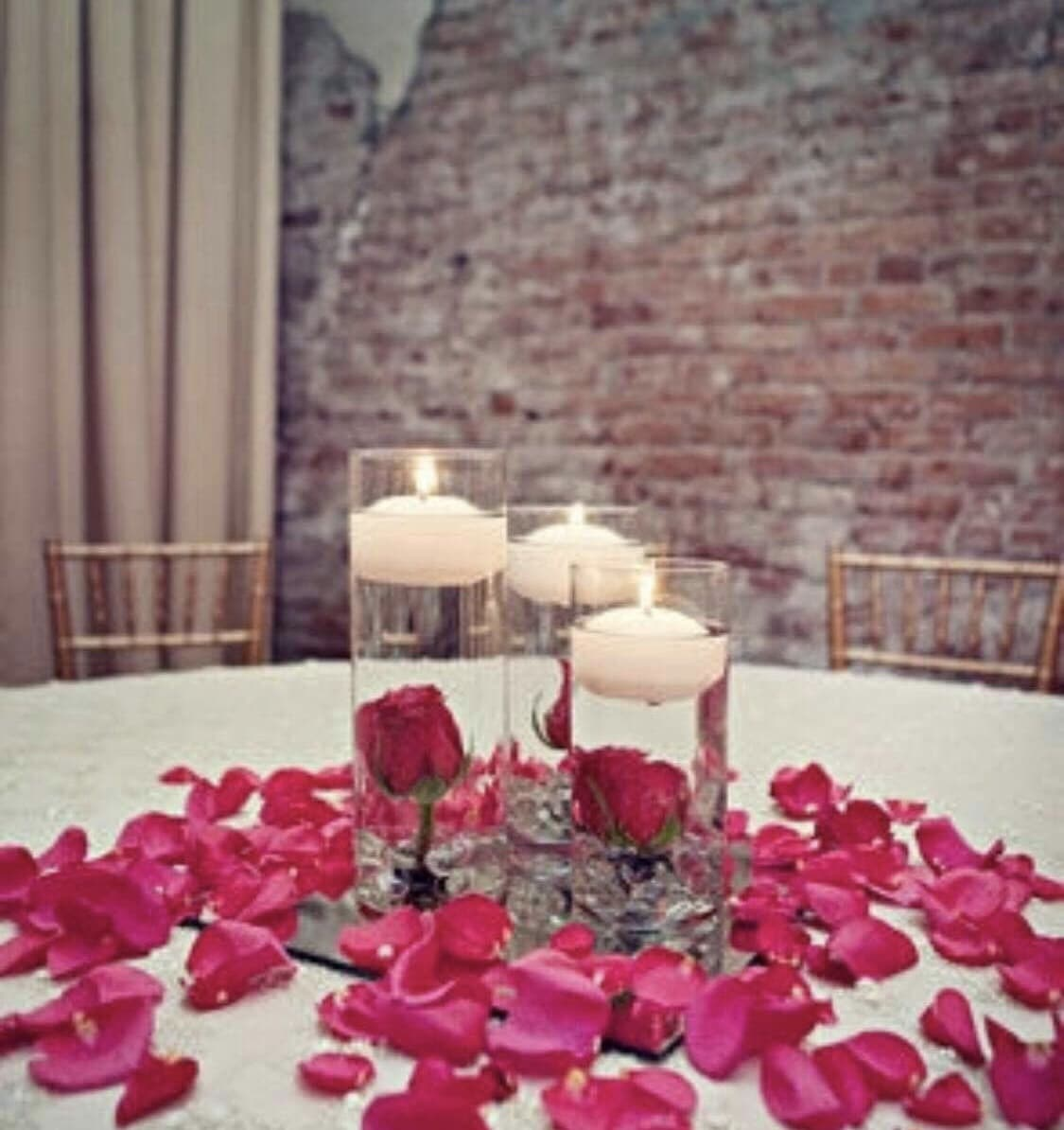 party gear centerpieces decoration with red roses and candle